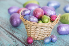 Pastel Easter chocolate eggs in a basket Royalty Free Stock Images