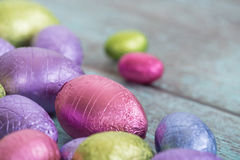 Pastel Easter chocolate eggs on vintage green background Royalty Free Stock Photos
