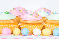 Pastel Easter cupcakes with candy and sprinkles Royalty Free Stock Photo