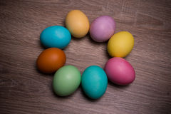 Pastel Easter Eggs Circle Isolated On Wooden background Royalty Free Stock Photos