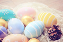 Pastel easter eggs on cloth Royalty Free Stock Images
