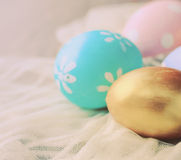 Pastel easter eggs on cloth, retro filter effect Stock Photos