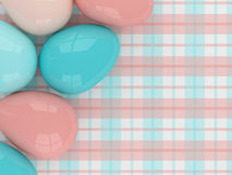 Pastel Easter eggs lying on plaid pattern Royalty Free Stock Photo