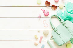 Pastel fashion accessories for girls on white. Pastel theme mood board with fashion accessories (bag, sunglasses, scarf) for girls. White rustic wooden royalty free stock image