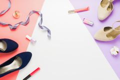 Pastel fashion flatlay arrangement with fashionable high heels shoes, cosmetics and other accessories. Concept of preparing or dressing oneself. Violet, pink royalty free stock images