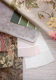 Pastel and floral swatches. Floral and pastel paint color and fabric swatches with a floor tile Stock Photos