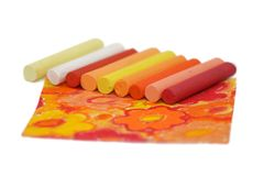 Pastel and flowers. Chalk pastel colored sticks on colored image with flowers Stock Photography