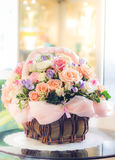 Pastel flowers in basket Royalty Free Stock Image