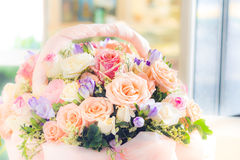 Pastel flowers in basket Stock Image