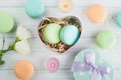 Pastel green gift box and macaroons Royalty Free Stock Image