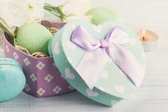Pastel green gift box and macaroons Royalty Free Stock Photo