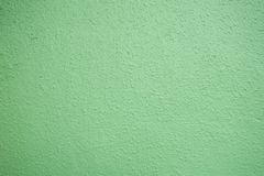 Pastel green plastered wall texture background Royalty Free Stock Photo