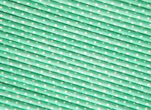 Pastel green polka dot paper straw background Stock Photo