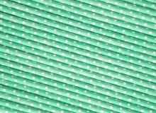 Pastel green polka dot paper straw background.  Stock Photo