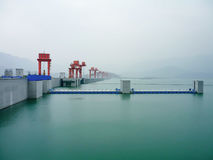 Pastel Green Serene sight on foggy day at the three Gorges Dam in China along Yangtze River. Blur backdrop of mountains and mist stock photography