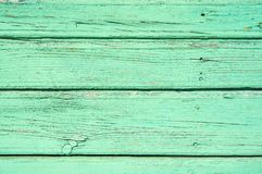 Pastel green stained wood background texture with horizontal parallel boards stock photo