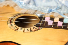 pastel guitar sugarcubes alphabet music beautiful Royalty Free Stock Image