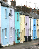 Pastel homes. Row of pastel coloured houses in English city stock image
