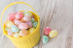 Pastel Jelly Beans in Yellow Basket Stock Image