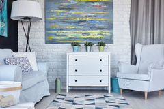 Pastel living room. With sofa, armchair, chest of drawers and painting stock photography