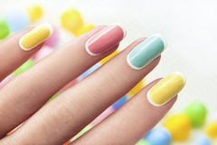 Pastel manicure. Manicure on an oval shaped nails in pastel colored tones Royalty Free Stock Photography