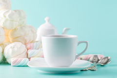 Pastel marshmallow and tea cup Royalty Free Stock Image