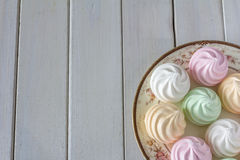 Pastel Meringues on Plate from Above Stock Photos