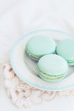 Pastel mint macaroon on light background Stock Photos