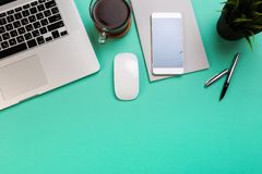 Pastel office desk table with laptop, and supplies. Top view with copy space, flat lay royalty free stock photography
