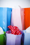 Pastel and orange assorted paper shopping bags. Assorted colorful paper gift bags Stock Image