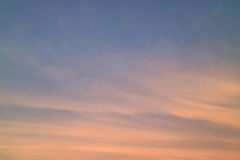 Pastel Orange and Blue Tropical Sunset Sky with the Airplane Royalty Free Stock Photography