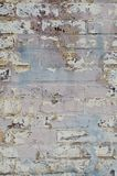 Pastel painted brick wall peels and fades stock image