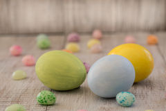 Pastel Painted Easter Eggs and Jelly Beans on Wood Background. Pastel Easter Eggs and jelly beans on wood background Stock Images