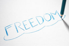 Pastel pencil writing the word Freedom Stock Photos