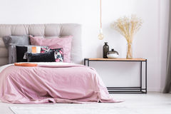 Pastel pink bedroom with flowers Royalty Free Stock Photo