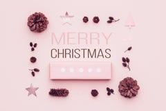 Pastel pink minimal christmas background. Beautiful christmas gift isolated on pastel pink background. Pink colored xmas gift box. Pastel pink minimal christmas royalty free stock photography