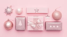 Pastel pink minimal christmas banner. Beautiful nordic christmas gifts isolated on pastel pink background. Pink colored wrapped xmas boxes composition stock photo