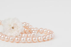 Pastel pink pearls with roses Stock Photo