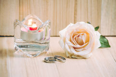 Pastel Pink Rose put near ang Engage Ring and  candlestick, Vale Royalty Free Stock Images