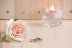 Pastel Pink Rose put near and Engage Ring and  candlestick, Vale Royalty Free Stock Photos