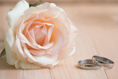 Pastel Pink Rose put near and Engage Ring and  candlestick, Vale Stock Photography