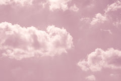 Pastel pink sky with white fluffy clouds. Fantasy pastel pink sky with white fluffy clouds royalty free stock photo
