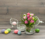 Pastel pink tulip flowers and easter eggs Royalty Free Stock Photography