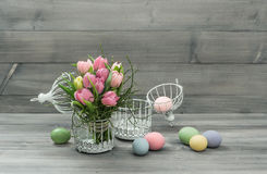 Pastel pink tulip flowers and easter eggs Royalty Free Stock Image