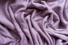 Pastel pink viscose fabric in soft folds. From above Stock Images