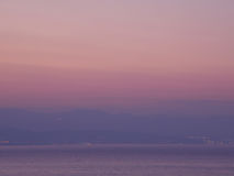 Pastel Pink and Yellow Color Gradation of the Sunset Sky over the Adriatic Sea, Croatia Royalty Free Stock Photos
