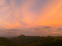 Pastel Purple and Orange Color of the Sunset Sky over Mountain Range Royalty Free Stock Photo