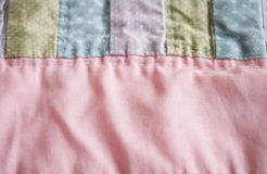 Pastel Quilt Background. A closeup of a pastel pink, blue, green and lavender quilt Stock Photography