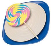 Pastel Rainbow Lollipop. On Stack of Plates Isolated on White with a Clipping Path Stock Photo