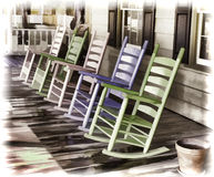 Pastel Rockers. An attractive group of pastel rocking chairs stock photos